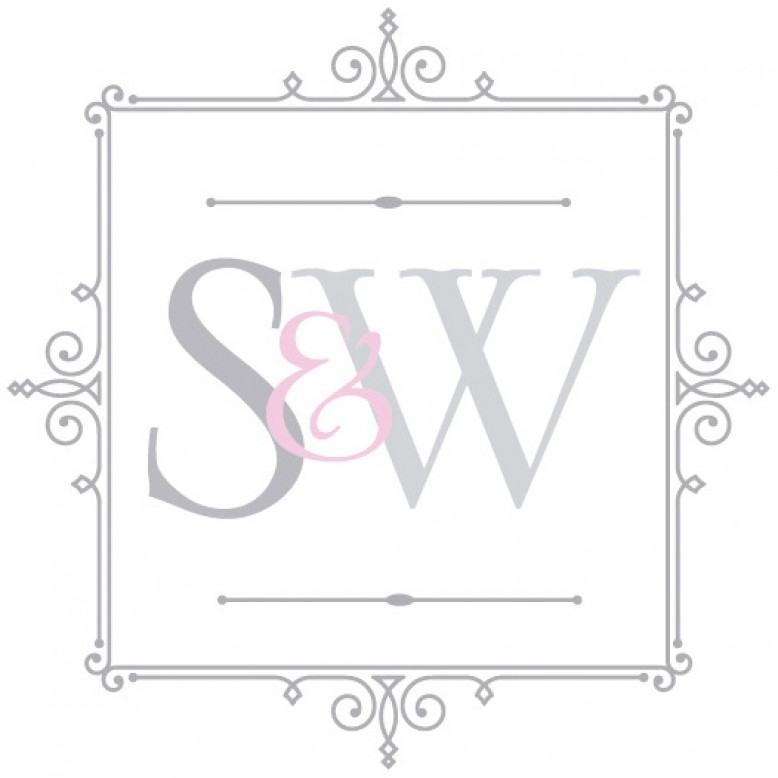 Sleek acrylic console table with glass table top and gold rim